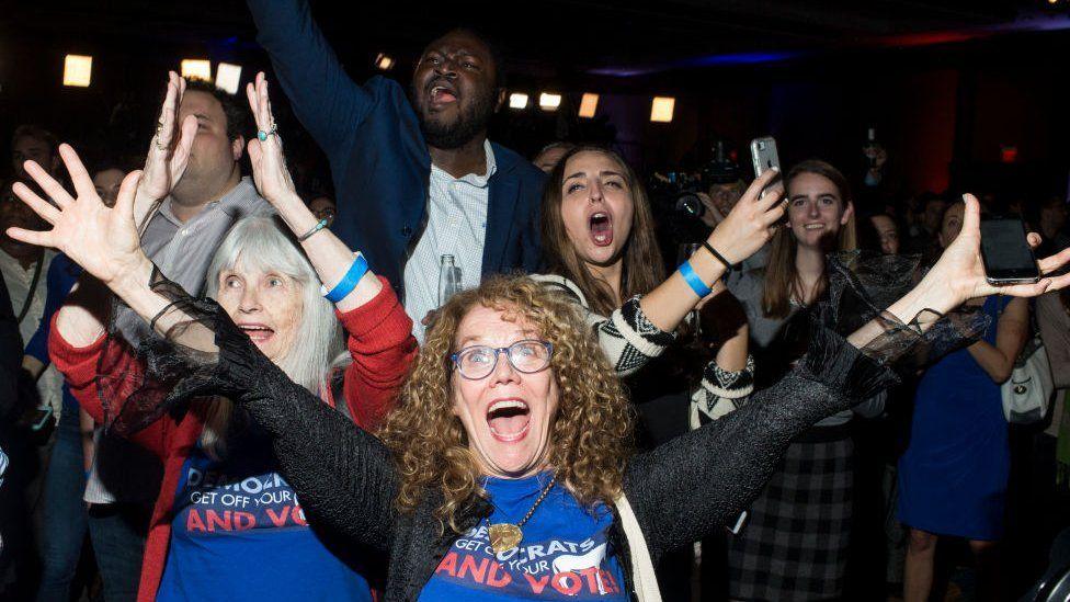 Democrat supporters celebrate