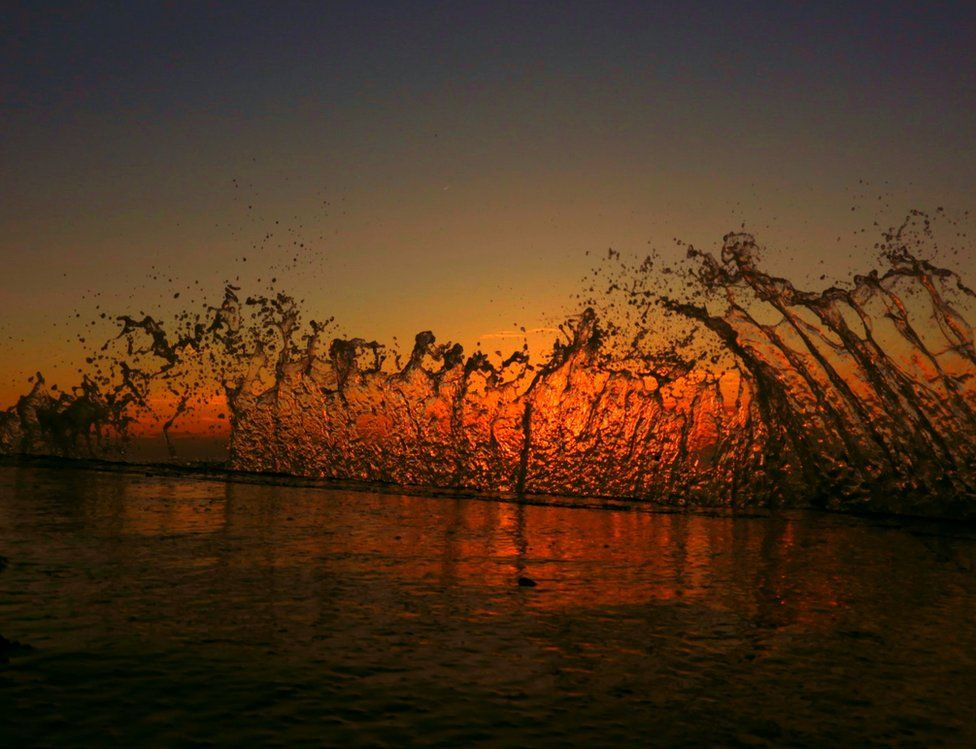 Splash of sea at sunset