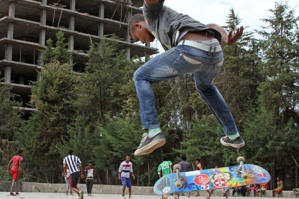 skateboarder pictured mid-flip