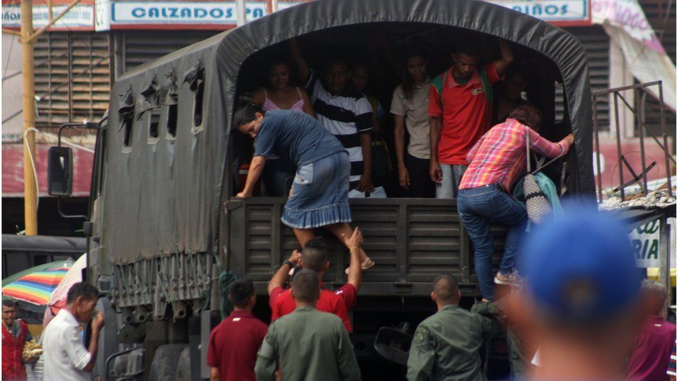 A Venezuelan military convoy transports a group of people for free in Maracaibo Venezuela on 19 July 2018.