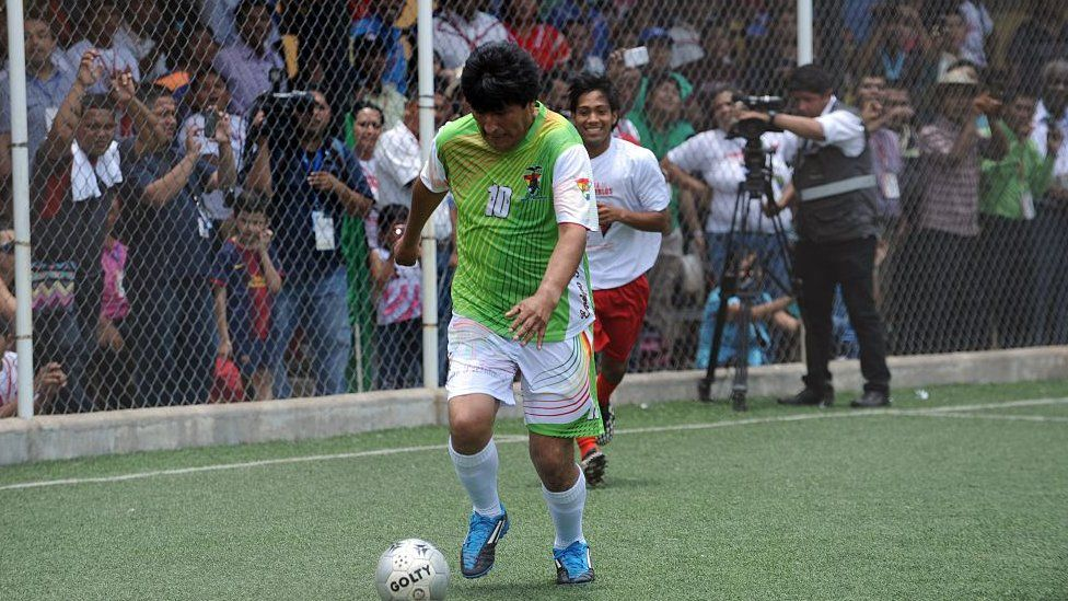 Bolivian President Evo Morales plays football during a friendly match in the framework of the Peoples Summit at the University of Panama on April 10, 2015.