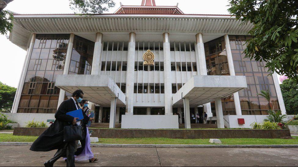 Sri Lankan lawyers walk past the Supreme Court complex in Colombo, Sri Lanka, 20 May 2020