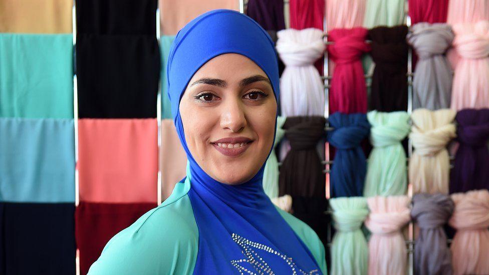 A Muslim model wears a burkini swimsuit