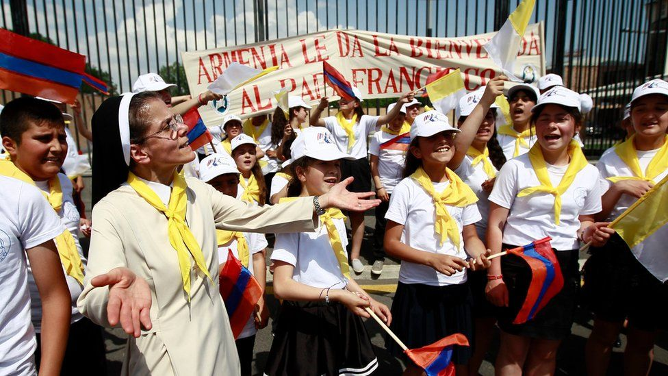 Young fans and supporters gather to welcome Pope Francis as he arrives at the Zvatnots International airport in Yerevan, Armenia, on 24 June