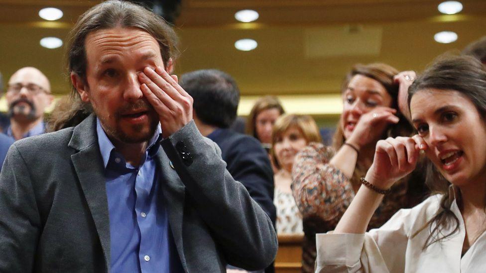 Podemos leader Pablo Iglesias and party member Irene Montero crying