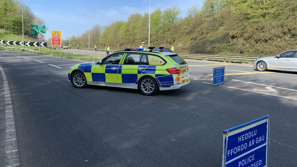 A police car at a check point on the A40