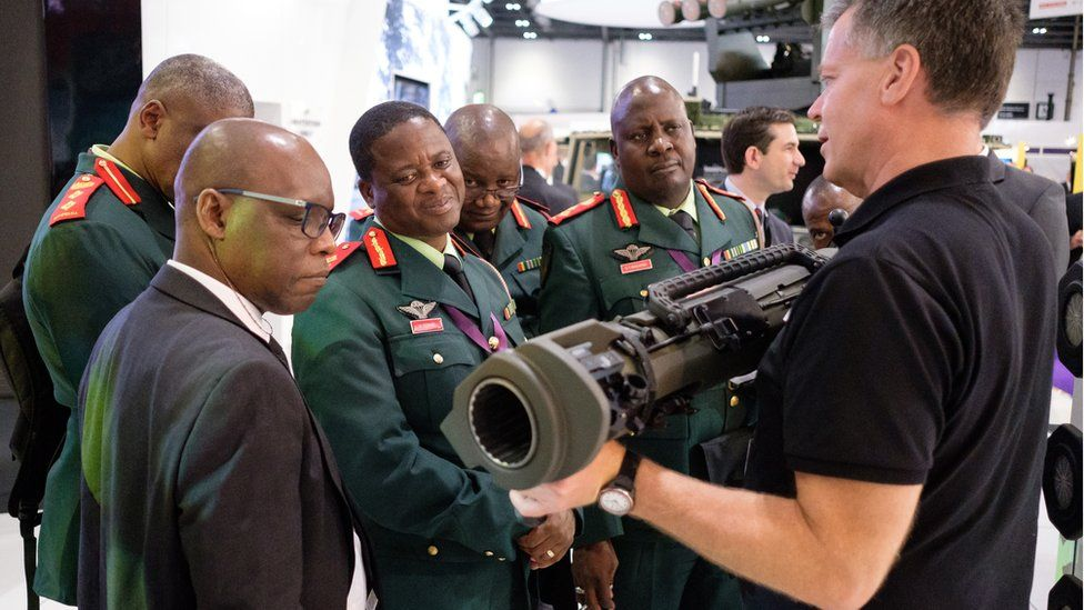 A group from the Botswana military are shown weapons by the SAAB team