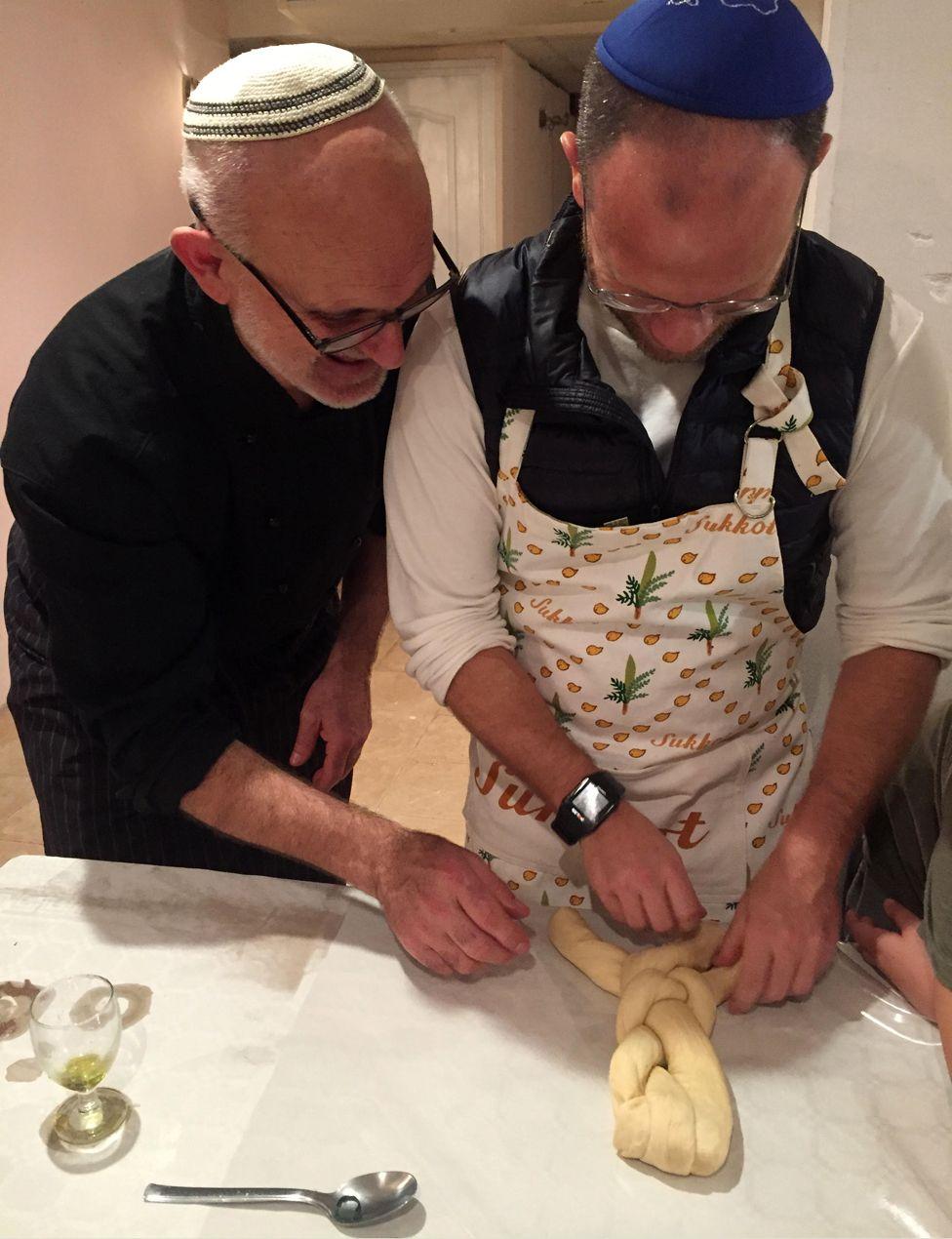 Toni, left, and Dani, making challah