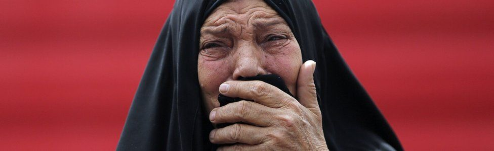 An Iraqi woman grieves at the scene of a deadly suicide car bomb attack in Baghdad on 9 June