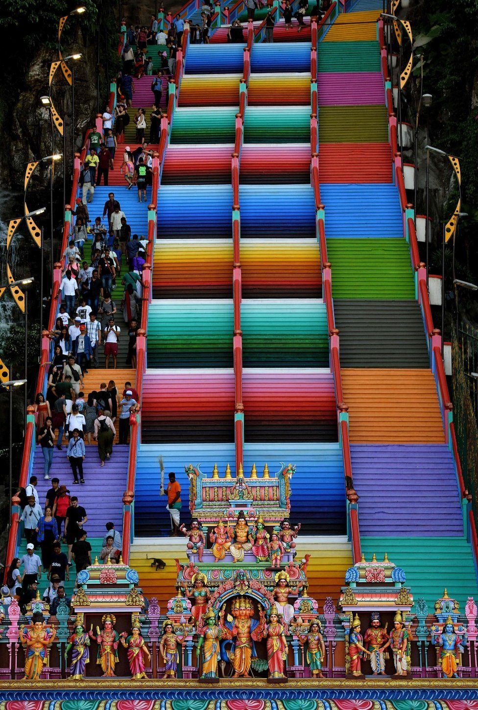 Visitors walk on the colourful stairs at Malaysia's Batu Caves