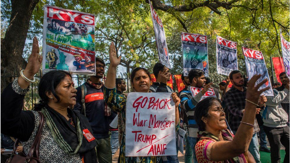 Activists of All India Democratic Students Organisation (AIDSO) hold placards as they shout slogans against the arrival of US President during a protest demonstration against US President Donald Trump