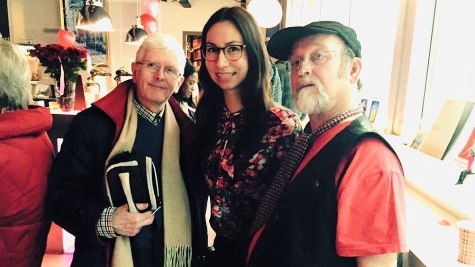 Danielle Smissaert with two elderly men