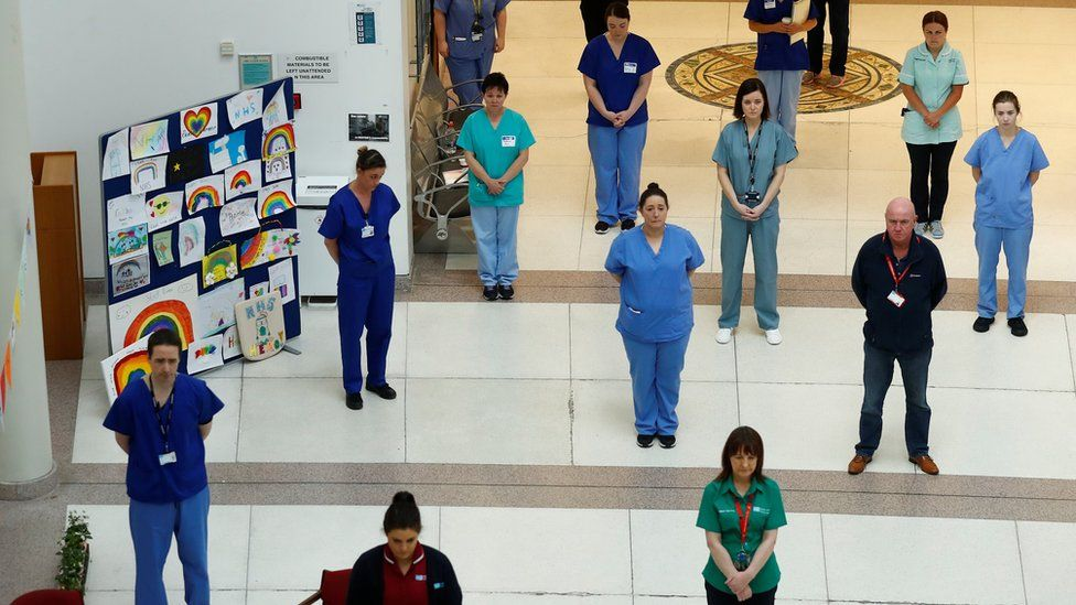 Staff at Belfast's Mater Hospital observe the minute's silence
