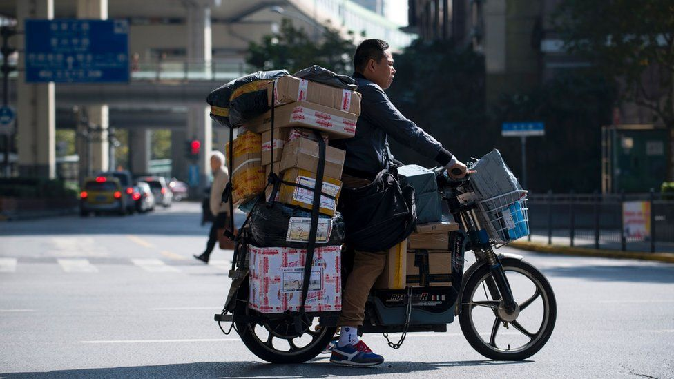 Image shows a delivery man in Shanghai on 11 November 2017