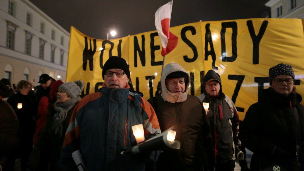 People hold candlelit demonstration against judicial reforms near the Presidential Palace in Warsaw, Poland December 14, 2017