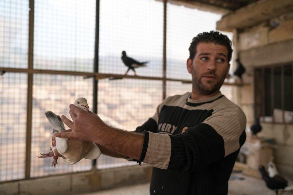 Mohammed Jomaa holding a bird, Anjar
