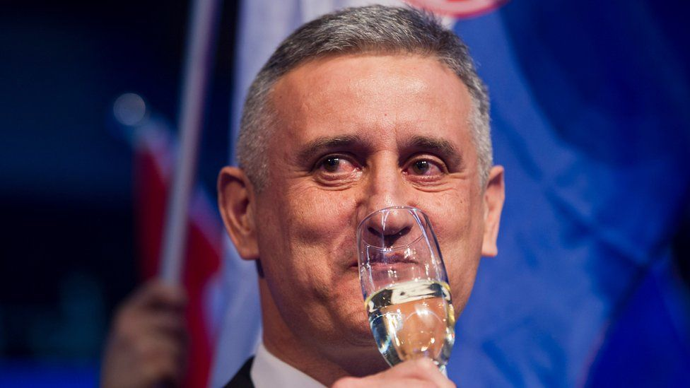 Opposition leader Tomislav Karamarko celebrates his coalition's winning of majority of votes, in Zagreb, Croatia, early Monday, Nov. 9, 2015.
