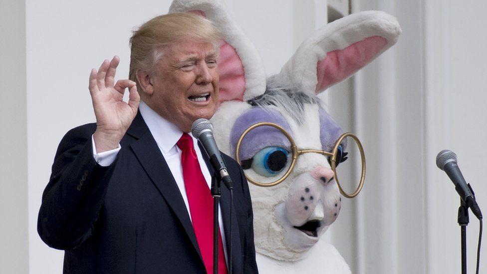US President Donald Trump speaks alongside the Easter Bunny
