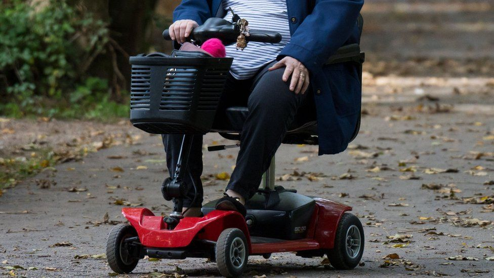 Woman in mobility scooter