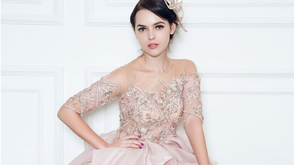 A model wearing a rose gold gown