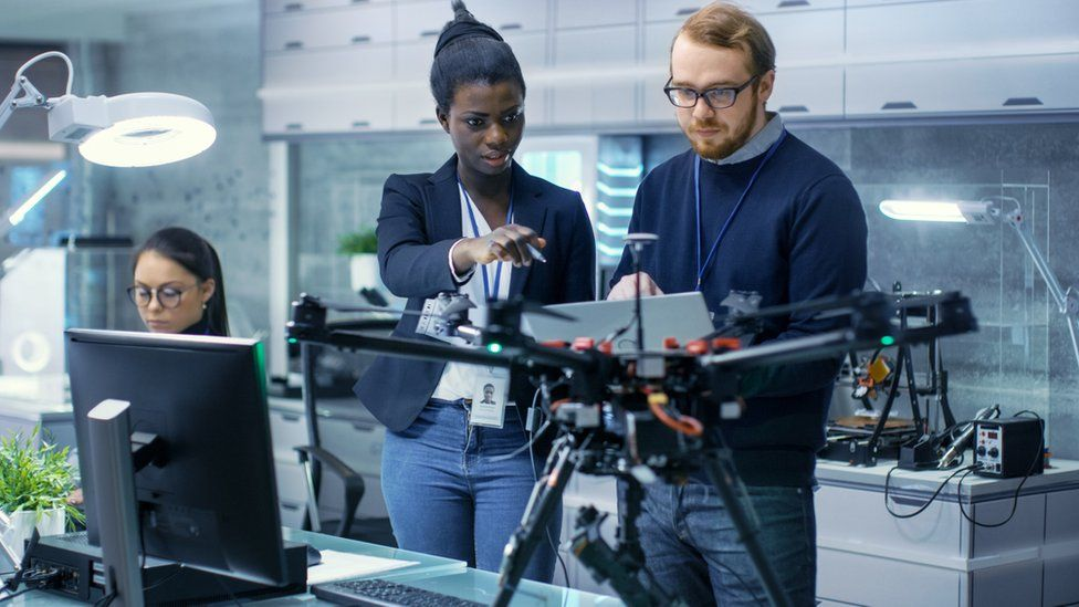 Man and woman work on drone project
