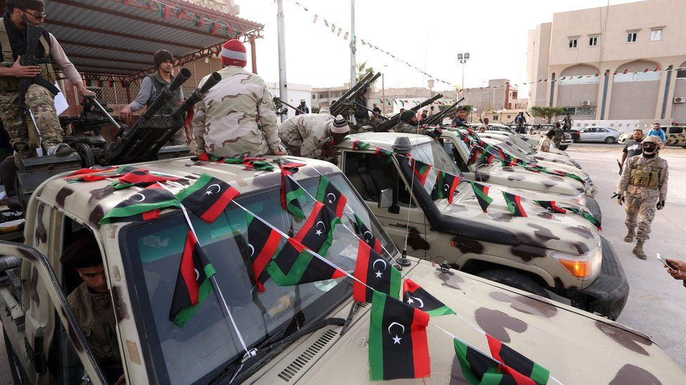 Members of a brigade loyal to Libya Dawn, an alliance of Islamist-backed fighters, during a military parade following battles against the Islamic State (IS) group, in the city of Sabratha, west of the capital Tripoli - 28 February 2016