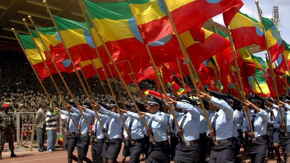 People marching with Ethiopia's flag on flag day