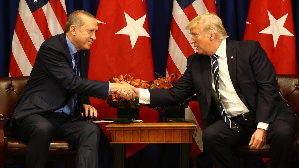 US President Donald Trump shakes hands with Turkish President Tayyip Erdogan.