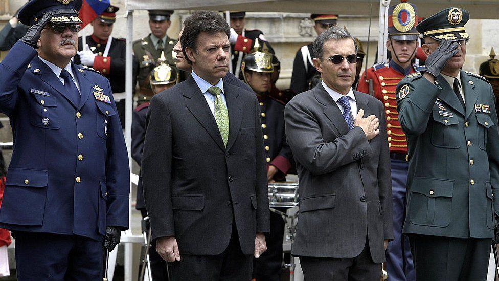 Alvaro Uribe and Juan Manuel Santos in a military parade