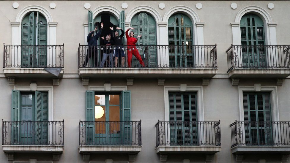 women on their Barcelona balcony