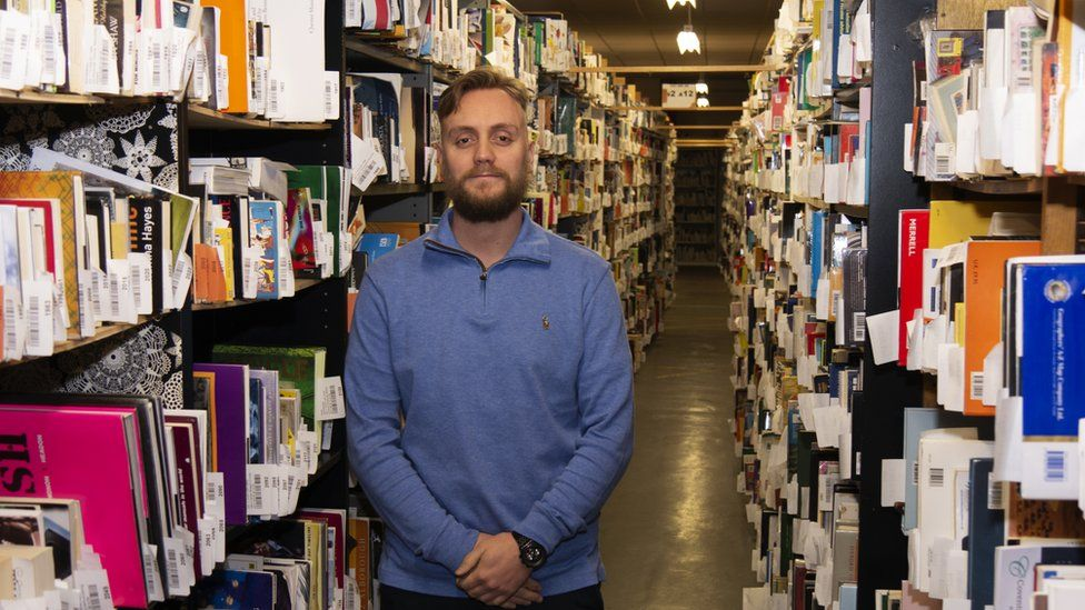 Ben Wadsworth, marketing manager at WeBuyBooks in their warehouse in Waterfoot, Rossendale.