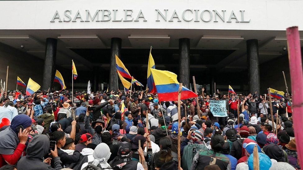 Demonstrators gather outside the National Assembly building, in Quito, Ecuador, October 8, 2019