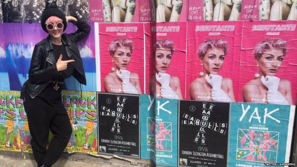 FEmme with her album posters