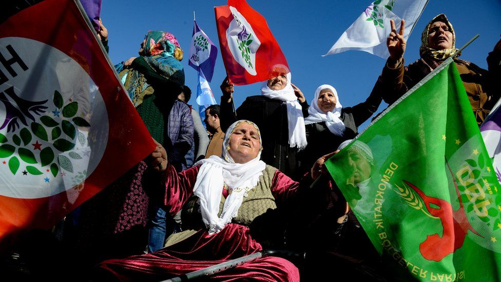 """Protesters hold flags of the Peoples"""" Democratic Party (HDP) during a rally in the Kurdish-majority city of Diyarbakir, south-eastern Turkey, on January 19 , 2019, in support of a jailed lawmaker who has been on hunger strike for more than two months."""