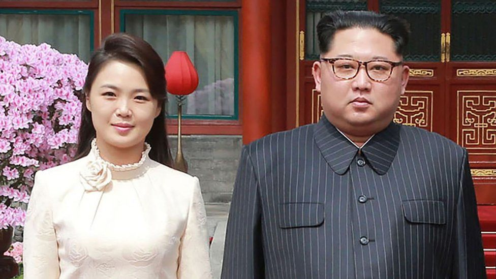 Kim Jong-un and his wife Ri Sol Ju pose for a picture in Beijing on 27 March 2018 in a photo released by KCNA