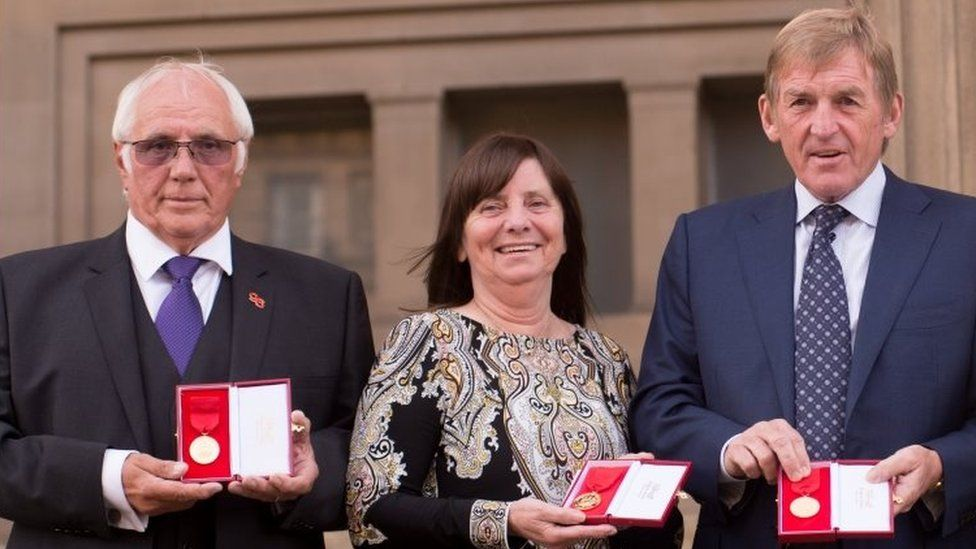 Trevor Hicks, Margaret Aspinall and Kenny Dalglish pose with Freedom of the City of Liverpool medals outside St George's Hall