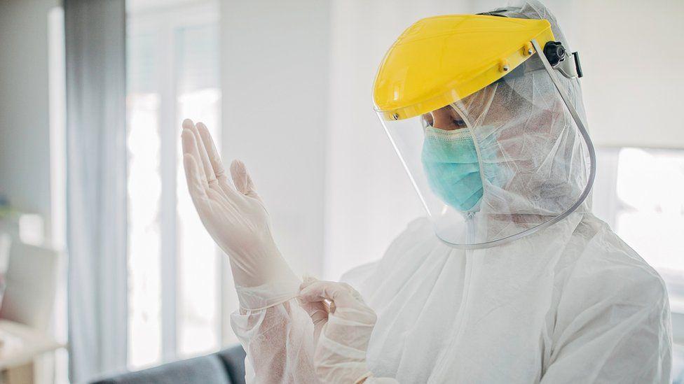 A health worker wearing PPE