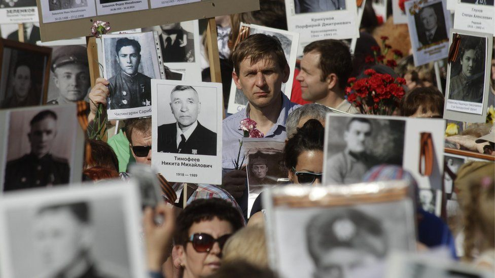 Participiants hold pictures of WW II soldiers in the Immortal Regiment march during the Victory Day celebration in Riga, Latvia, 09 May 2016. EPA/VALDA KALNINA