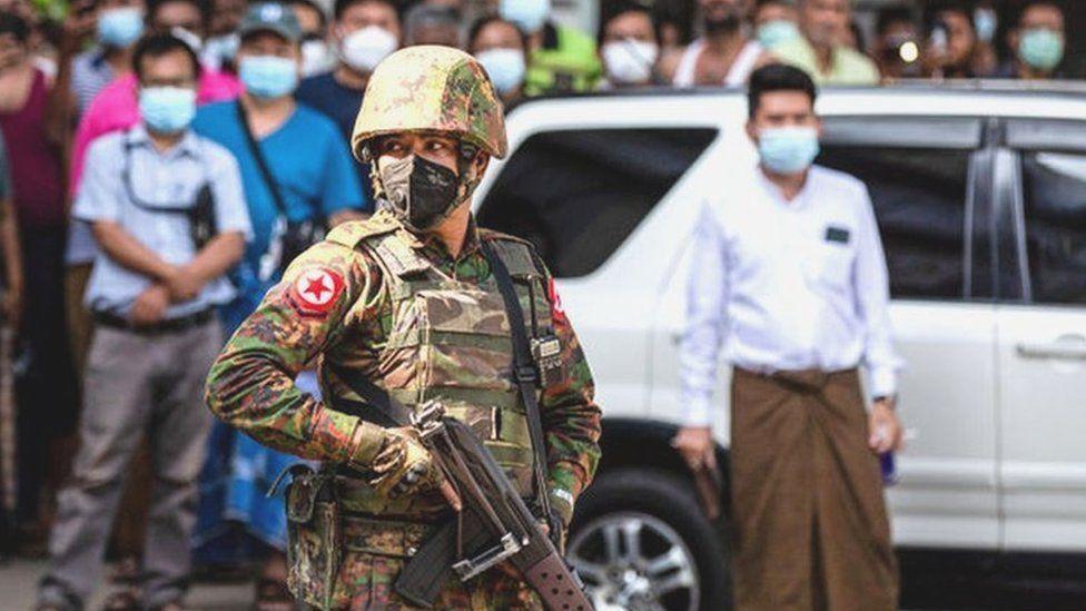 Soldier in crowd in Myanmar
