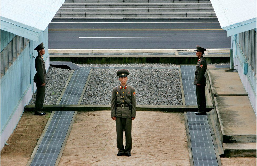 A North Korean soldier stands next to the demarcation line in Panmunjom, on the border between North Korea and South Korea Tuesday 7 August 2007