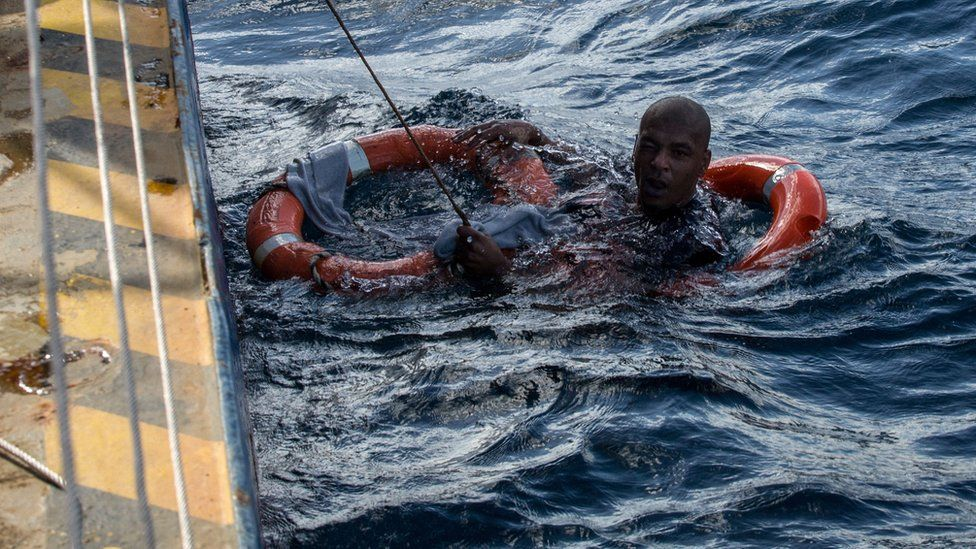 A migrant shown being rescued on January 4, 2019