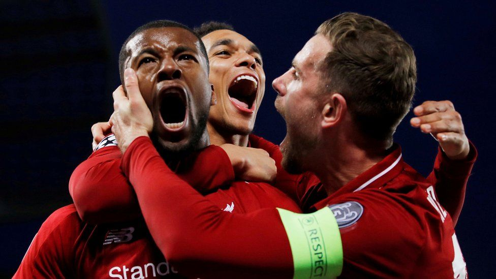 Liverpool's Georginio Wijnaldum with Jordan Henderson and Trent Alexander-Arnold