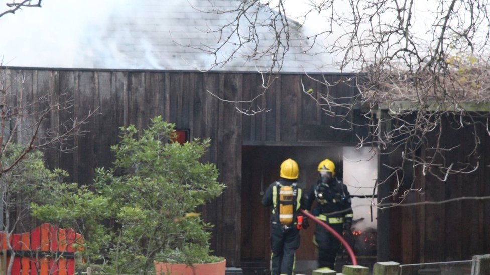 Firefighters tackling the blaze at London Zoo