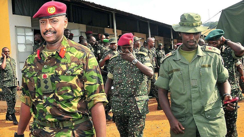 This photo taken on August 27, 2012, shows Brigadier Muhoozi Kainerugaba (L), new commander of the Ugandan Special Forces Command, at the Sera Kasenyi training centre for Special Forces in Kampala on August 16, 2012.