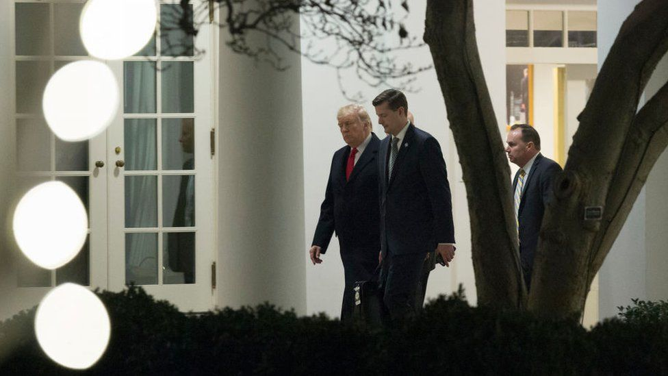 Mr Trump is seen walking with Mr Porter at the White House in December 2017