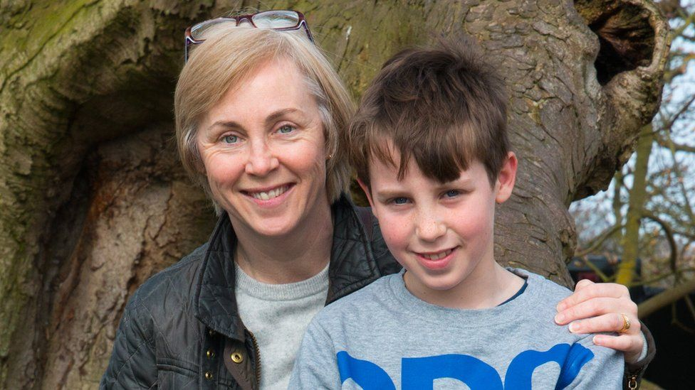 Luke Hobson and his mother