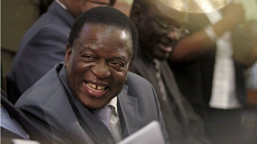 """Zimbabwe Vice-President Emmerson Mnangagwa listens as President Robert Mugabe (not pictured) delivers his state of the nation address to the country""""s parliament in Harare, on 25 August 2015."""
