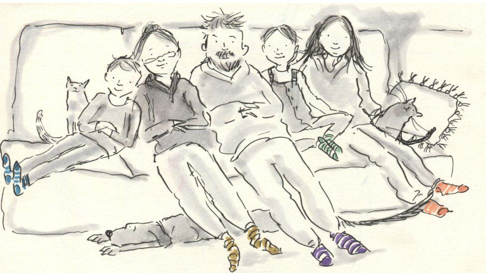 The whole family together on the sofa