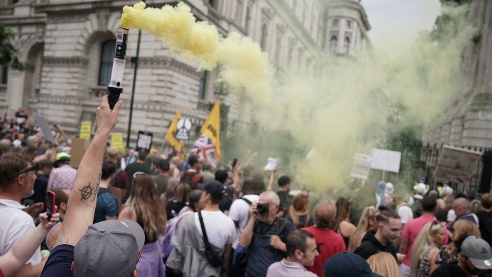 Protesters let off flares outside Downing Street