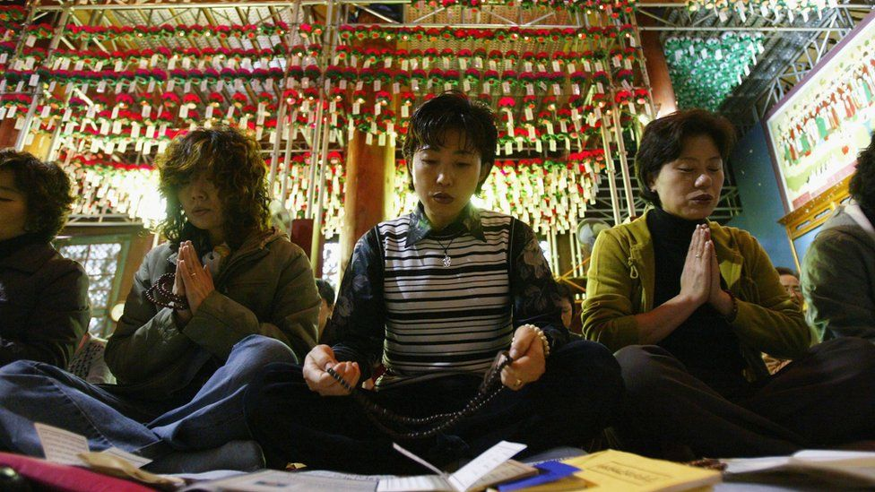 Parents pray for their children during their exams in Korea